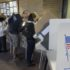 FILE - This Oct. 30, 2012 file photo shows people voting early at the Salt Lake County Government Building in Salt Lake City, ahead of the Nov. 6 election. There's always grousing about people who don't bother to vote. But look at it another way: An estimated 133 million Americans will cast ballots in Tuesday's election. That's about 6 in 10 eligible adults. Some will persevere despite long lines, pressing personal burdens or the devastation left by Superstorm Sandy. Why do they do it? It's not because any one voter will decide the contest between President Barack Obama and Mitt Romney. Depending on which state they live in, the odds of casting a deciding vote for president are somewhere between 1 in a million and essentially zero. (AP Photo/Rick Bowmer, File)