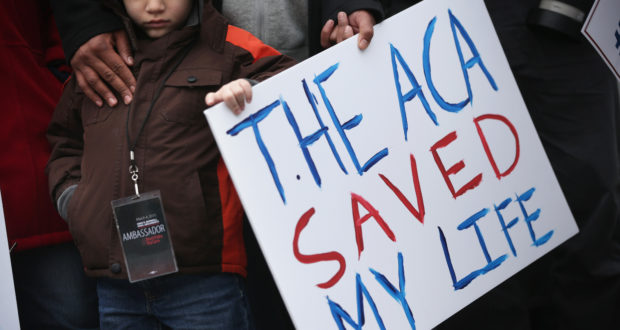 WASHINGTON, DC - MARCH 04:  Five-year-old James Cook of Cleveland, Ohio, participates in a rally to support the Affordable Care Act in front of the U.S Supreme Court March 4, 2015 in Washington, DC. The Supreme Court was scheduled to hear oral arguments in the case of King v. Burwell that could determine the fate of health care subsidies for as many as eight million people.  (Photo by Alex Wong/Getty Images)