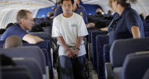 Juan Sacaria Lopez, an illegal immigrant, boards a plane during his deportation process in Phoenix, Arizona in this file photo taken July 10, 2009. The Obama administration will relax enforcement of deportation rules for young people brought to the United States without legal status, a softening of immigration policy that is likely to appeal to Hispanic voters in an election year.  REUTERS/Carlos Barria/Files   (UNITES STATES DAY - Tags: POLITICS SOCIETY IMMIGRATION) USA-IMMIGRATION/